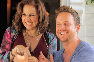 Film Still BEARCITY 2: THE PROPOSAL by director Doug Langway; Stephen Guarino and Kathy Najimy are holding hands and laugh