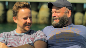 Film Still BEARCITY 2: THE PROPOSAL by director Doug Langway; bear couple Brian Keane and Stephen Guarino are sun bathing