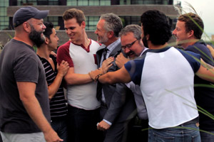 Film Still BEARCITY 2: THE PROPOSAL by director Doug Langway; a group of friends (Brian Keane, Joe Conti, Stephen Guarino, Gerald McCullouch, Gregory Gunter, James Martinez, Alex Di Dio) is celebrating on the roof of a city building