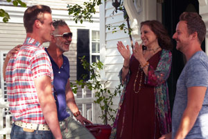 Film Still BEARCITY 2: THE PROPOSAL by director Doug Langway; Kathy Najimy and Stephen Guarino welcome the gay bear couple Brian Keane and Joe Conti in front of their home